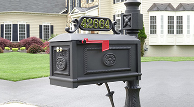 Residential black BB-B decorative cast aluminum mailbox with 2 inch brass numbers in a California neighborhood
